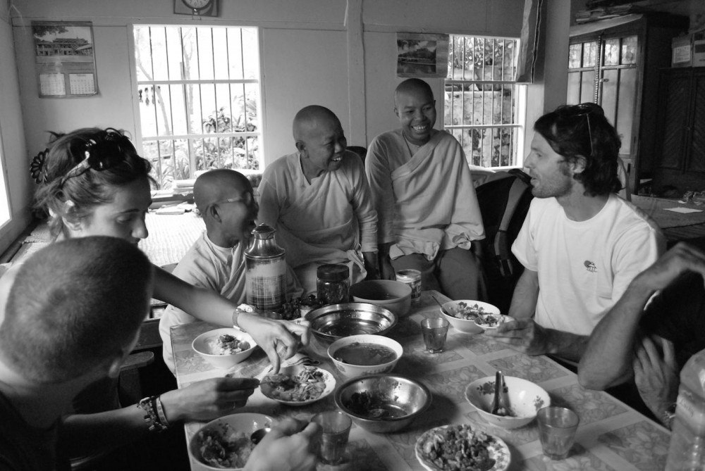 Buddhist Nuns sharing food with travellers