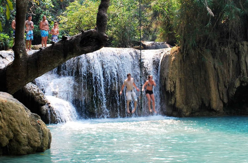 jumping in at khoungsi waterfalls luang prabang