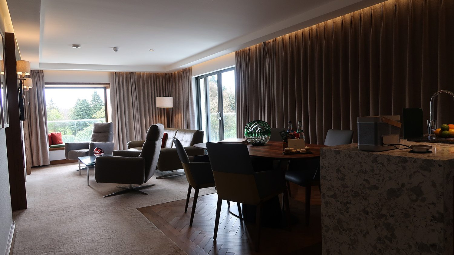 Large hotel suite with mid-century modern style furniture