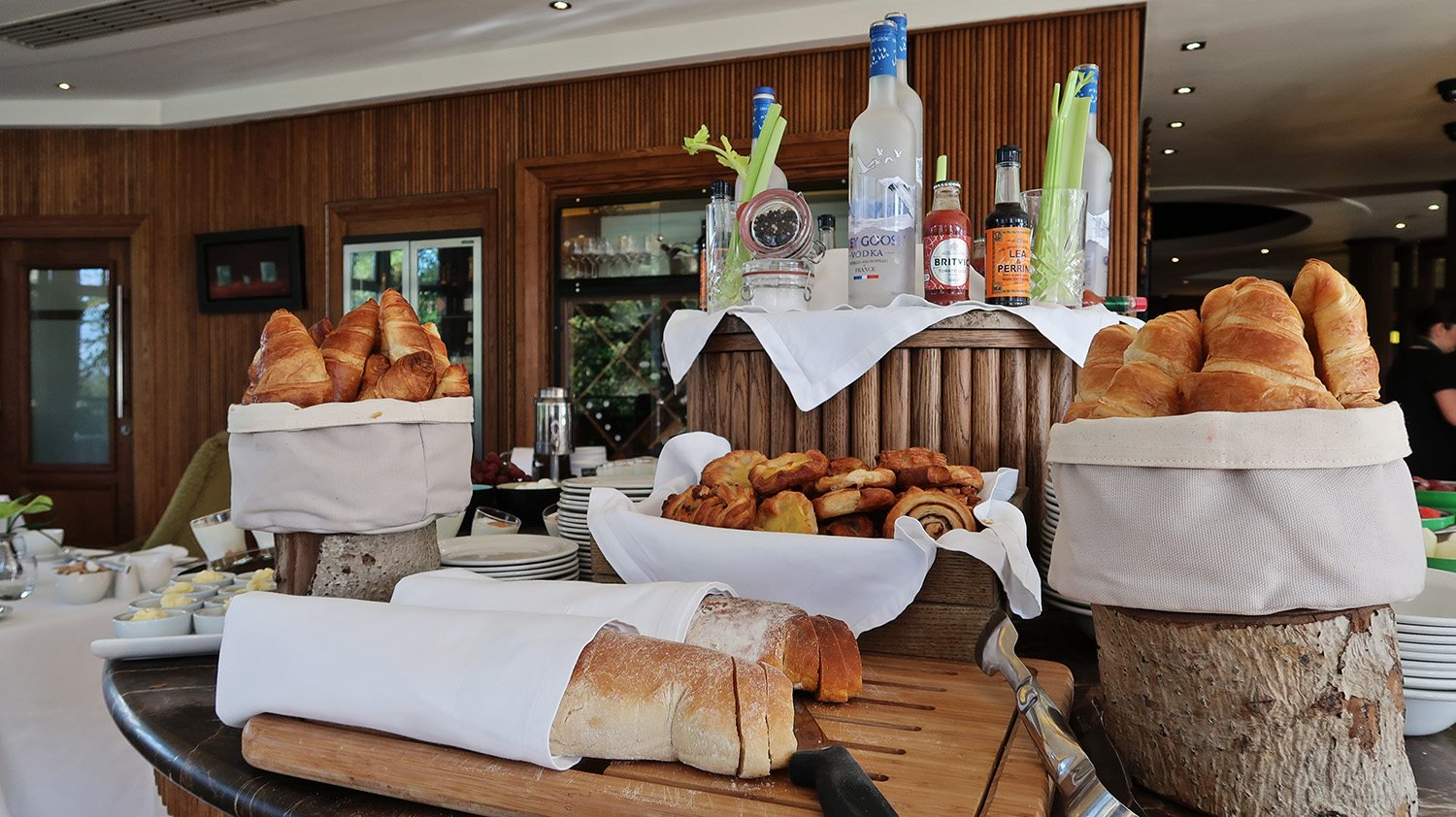Baskets of bread laid out on the buffet table