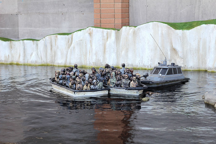 Refugees by Banksy at Dismaland