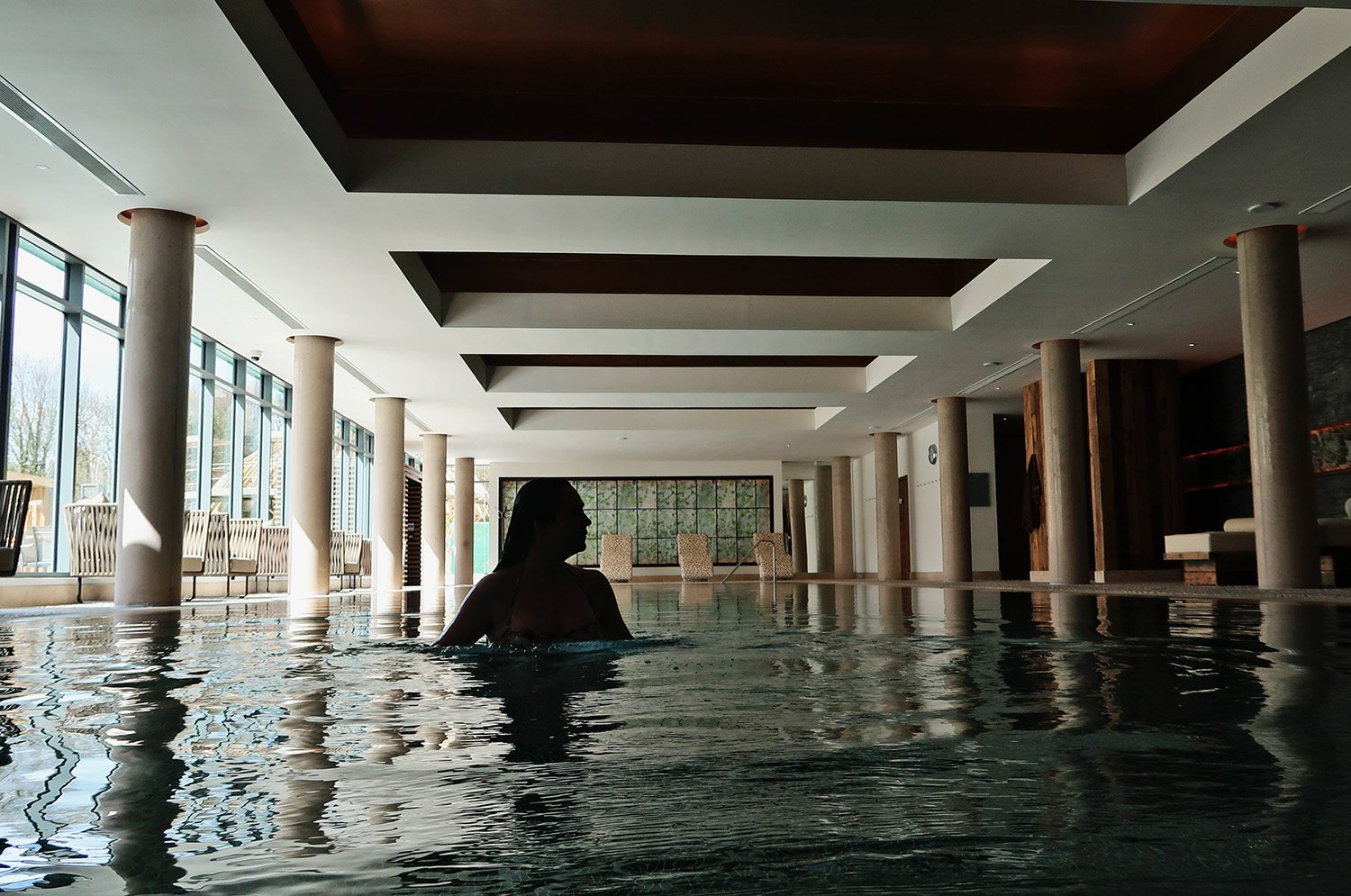Silhouette of woman in an indoor swimming pool